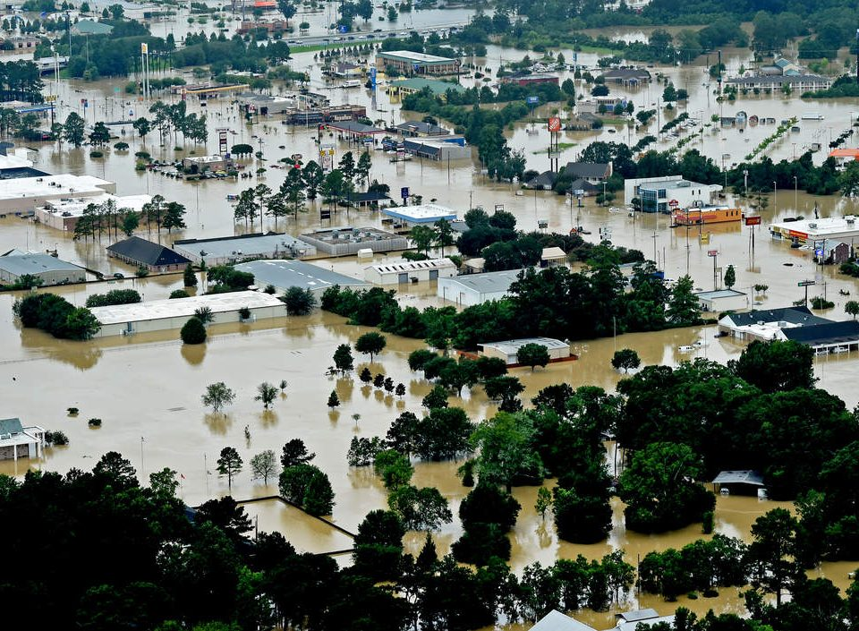 This aerial image shows flooded areas in Denham Springs, La., Saturday, Aug. 13, 2016. Louisiana Gov. John Bel Edwards says more than 1,000 people in south Louisiana have been rescued from homes, vehicles and even clinging to trees as a slow-moving storm hammers the state with flooding. (Patrick Dennis/The Advocate via AP)           NYTCREDIT: Patrick Dennis/The Advocate, via Associated Press